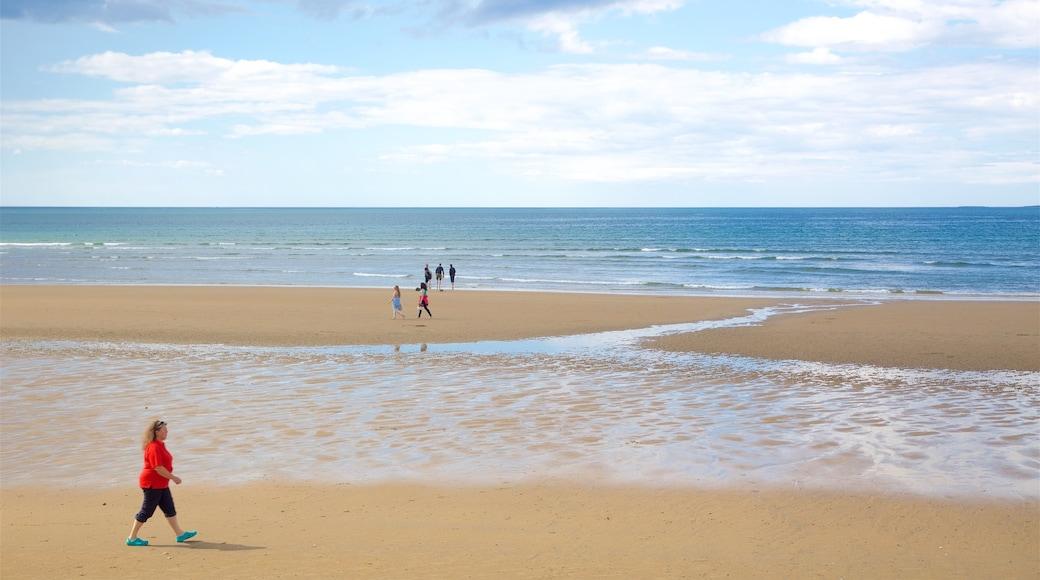 Strandhill Beach showing general coastal views and a sandy beach as well as an individual female