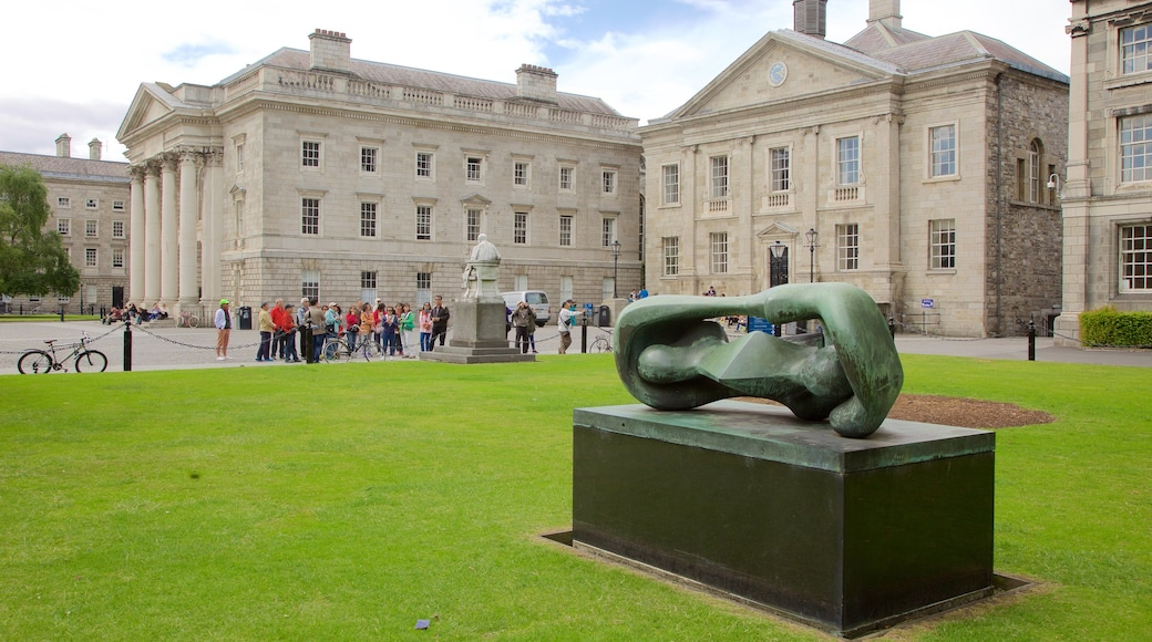Trinity College featuring outdoor art, a statue or sculpture and heritage architecture