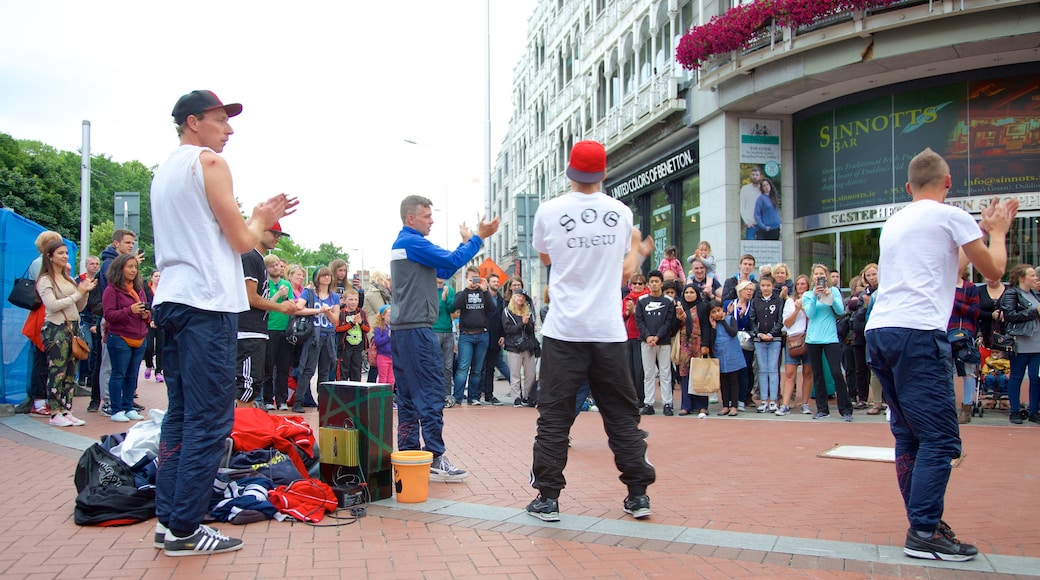 Grafton Street which includes street scenes, a city and street performance