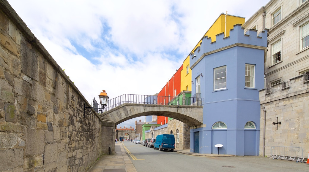 Dublin Castle featuring a bridge, heritage elements and heritage architecture