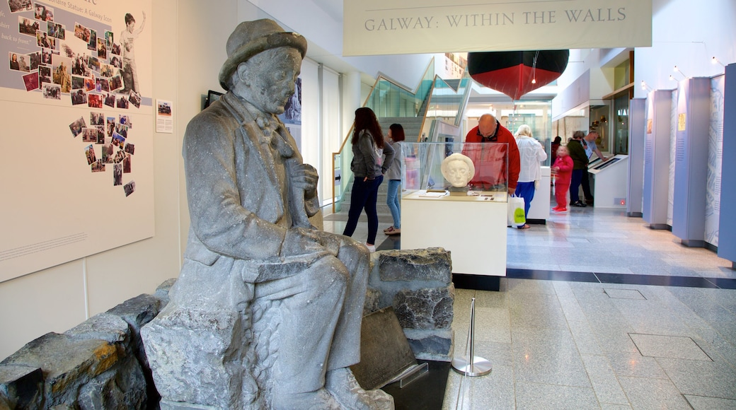 Galway City Museum showing interior views and a statue or sculpture as well as a small group of people