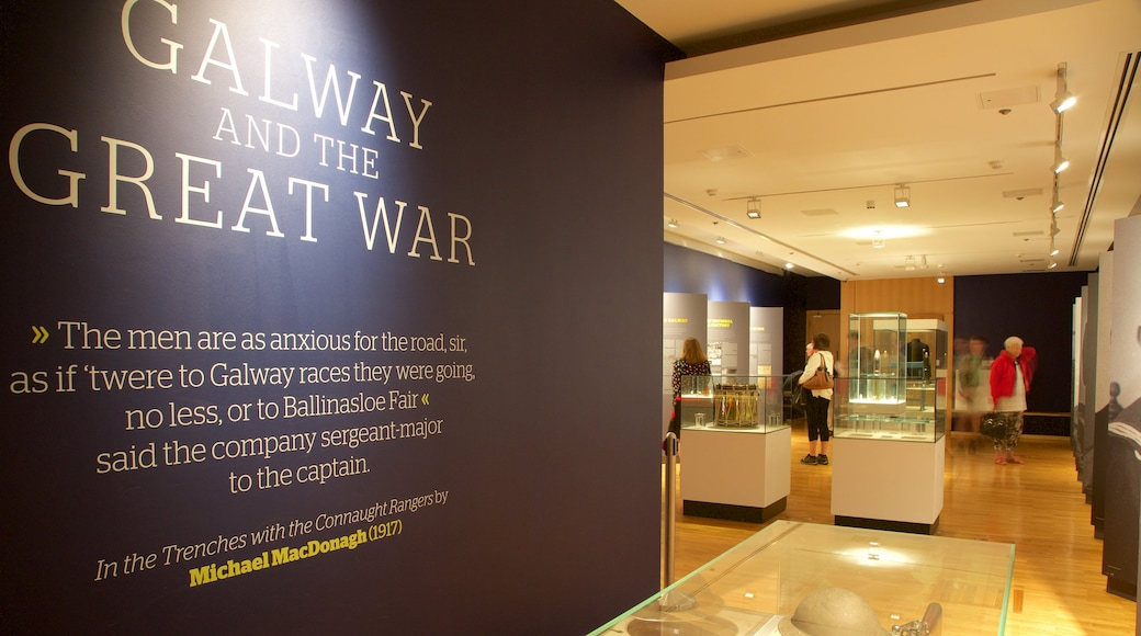 Galway City Museum featuring military items, interior views and signage