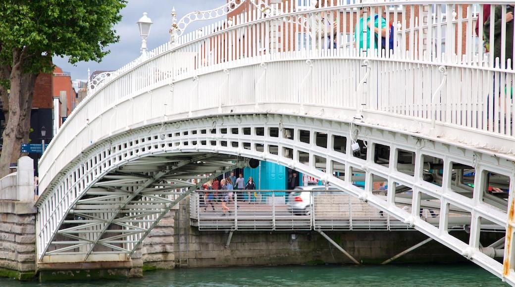 Ha\' Penny Bridge featuring a bridge, a city and a river or creek