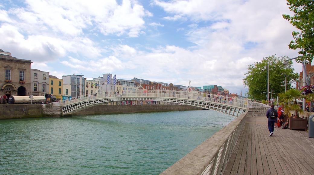 Ha\' Penny Bridge featuring a city, a bridge and a river or creek