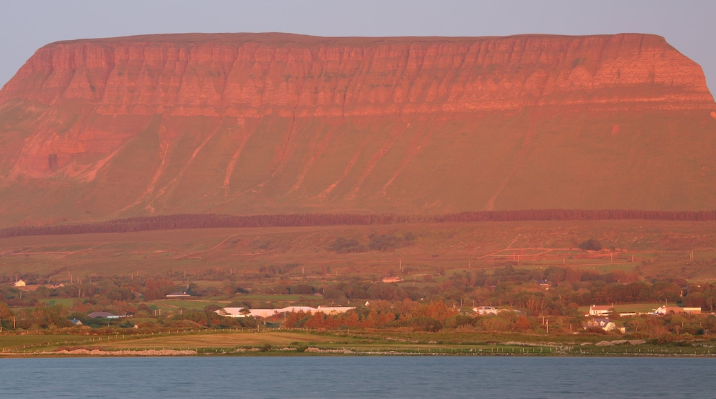 Ben Bulben showing a sunset, a river or creek and mountains