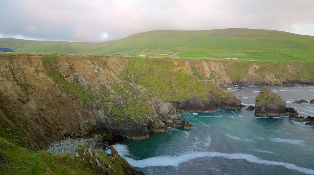Slea Head which includes tranquil scenes, general coastal views and rocky coastline