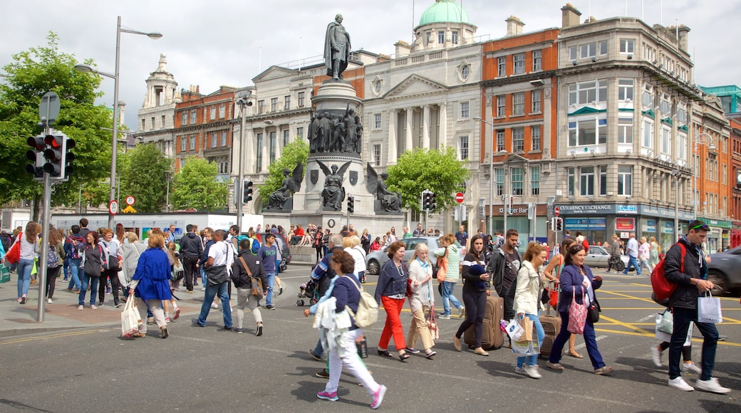 Dublin showing a square or plaza and a city as well as a large group of people