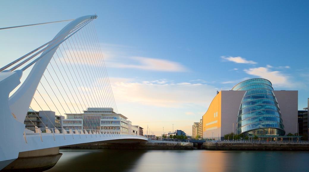 Dublin showing modern architecture, night scenes and a bridge
