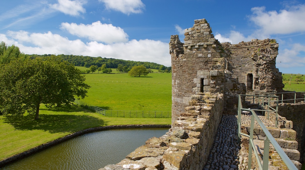 Beaumaris Castle showing heritage elements, a river or creek and heritage architecture