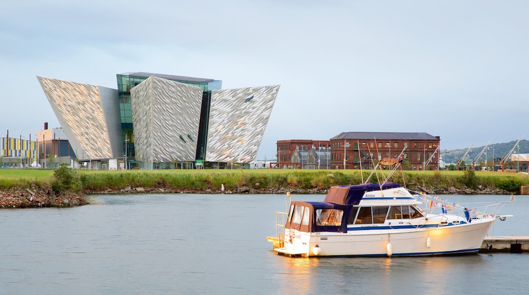 Titanic Belfast featuring modern architecture, boating and a river or creek