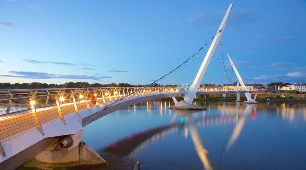 Peace Bridge featuring a city, a sunset and a river or creek