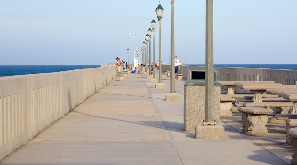 Wrightsville Beach showing general coastal views as well as a small group of people