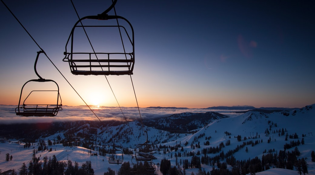 Squaw Valley Resort featuring a gondola, a sunset and snow