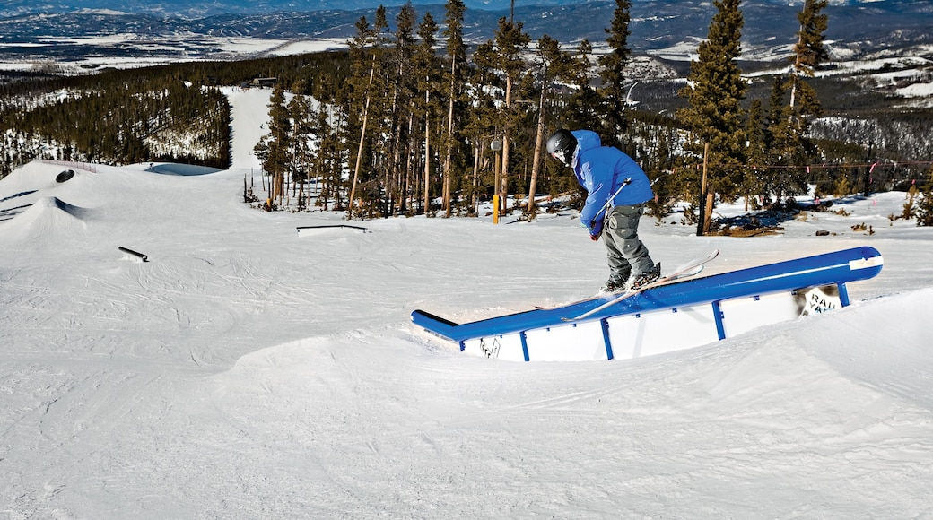 Winter Park Ski Resort featuring snow skiing and snow as well as an individual male