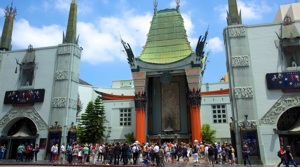 Hollywood Boulevard which includes a square or plaza and a city as well as a large group of people