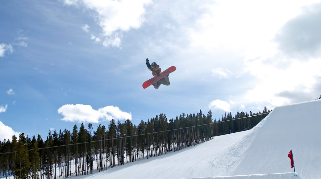 Breckenridge Ski Resort which includes snow and snow boarding as well as an individual male