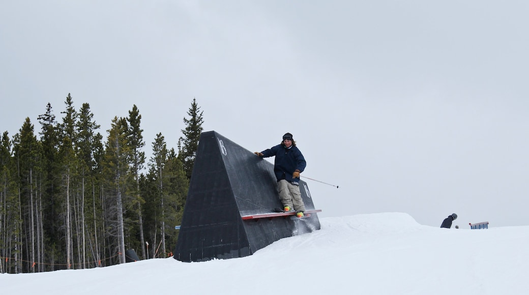 Breckenridge Ski Resort which includes snow skiing and snow as well as an individual male