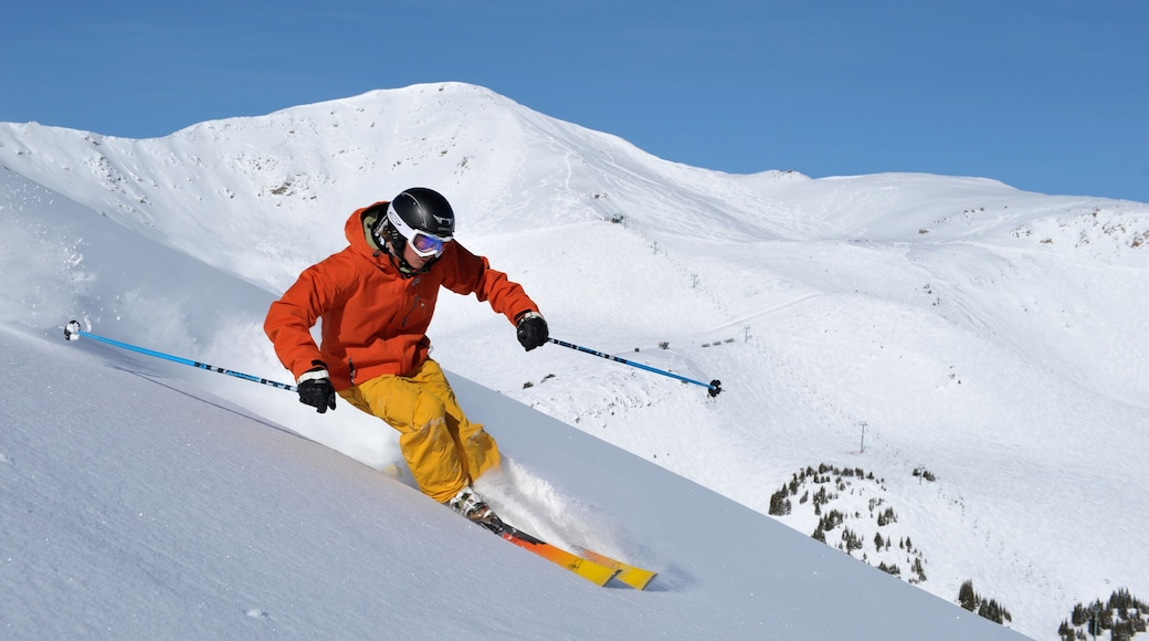 Marmot Basin showing snow skiing and snow as well as an individual male