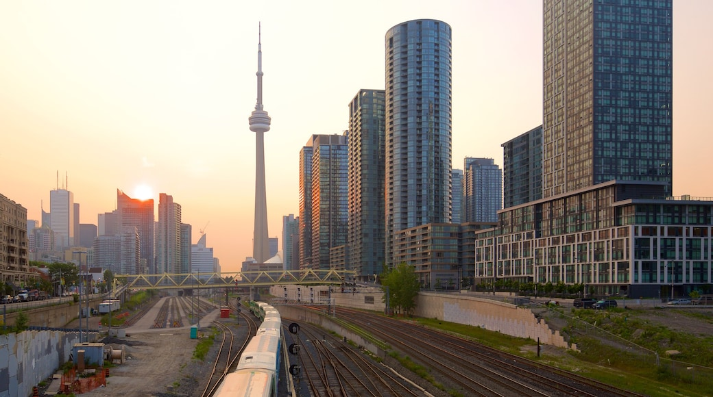 Toronto showing a high-rise building, railway items and a sunset