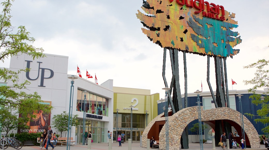 Vaughan Mills Mall featuring a square or plaza and signage as well as a small group of people