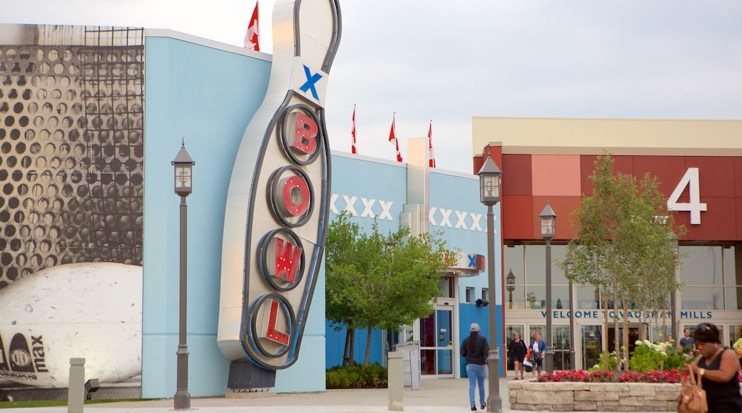 Vaughan Mills Mall which includes a square or plaza and signage as well as a small group of people