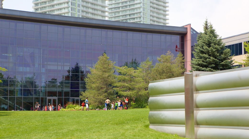 Living Arts Centre featuring a garden as well as a small group of people