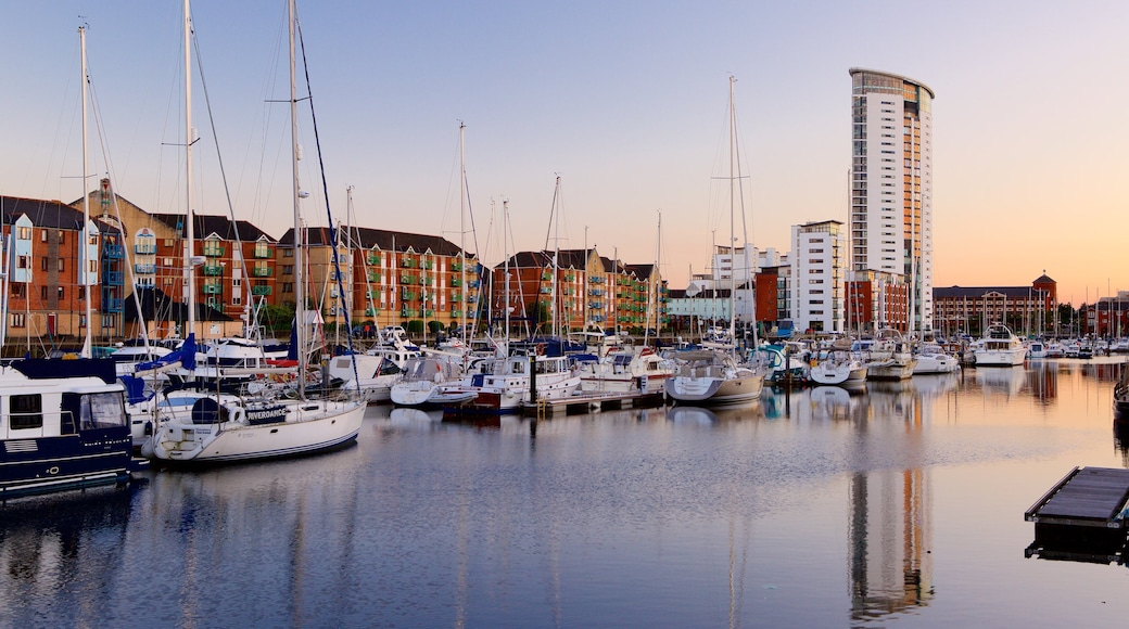 Swansea which includes a sunset, general coastal views and sailing