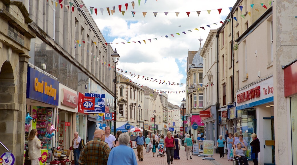 Neath which includes street scenes as well as a large group of people