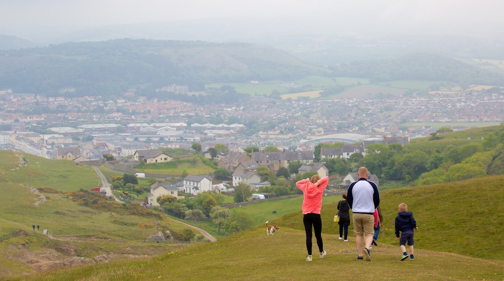 Great Orme featuring hiking or walking and farmland as well as a family