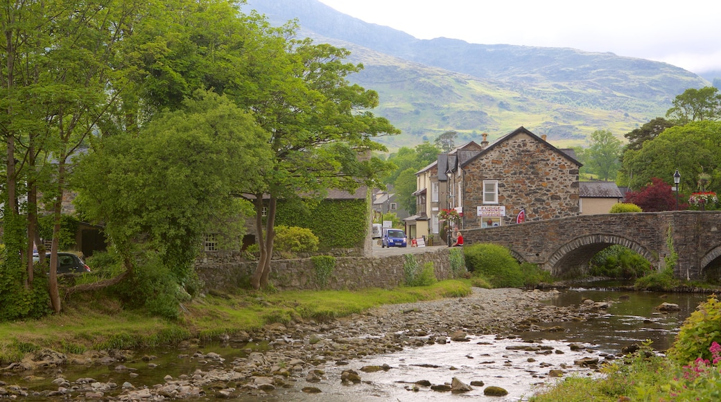 Beddgelert which includes a small town or village, a river or creek and a bridge