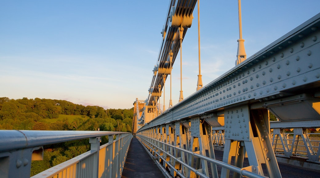 Menai Bridge featuring a bridge and a sunset