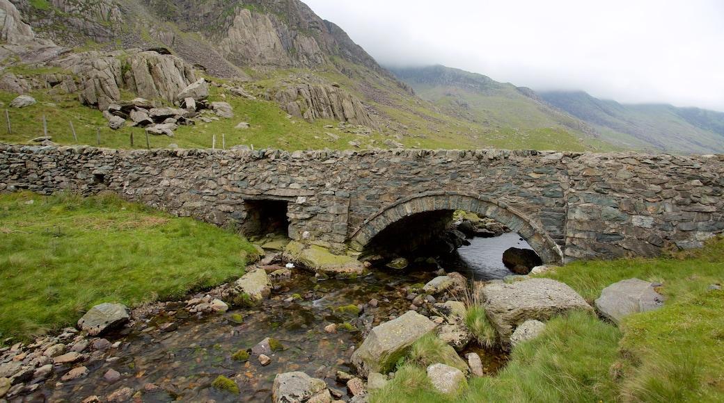 Snowdonia National Park featuring a river or creek, farmland and a bridge