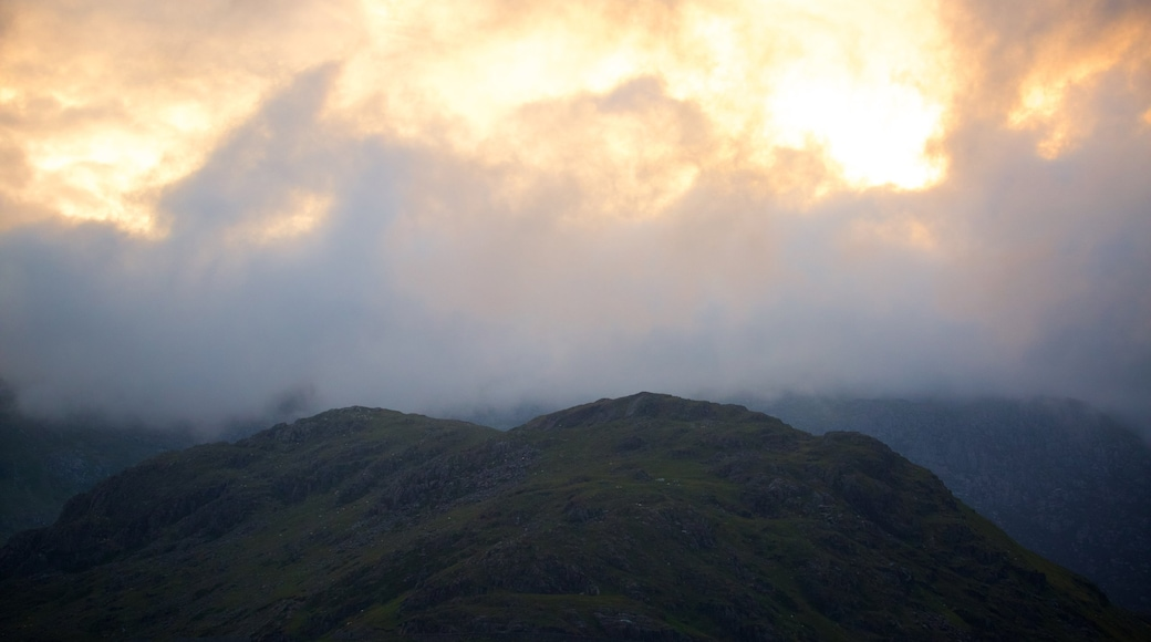Mount Snowdon showing a sunset, mountains and mist or fog