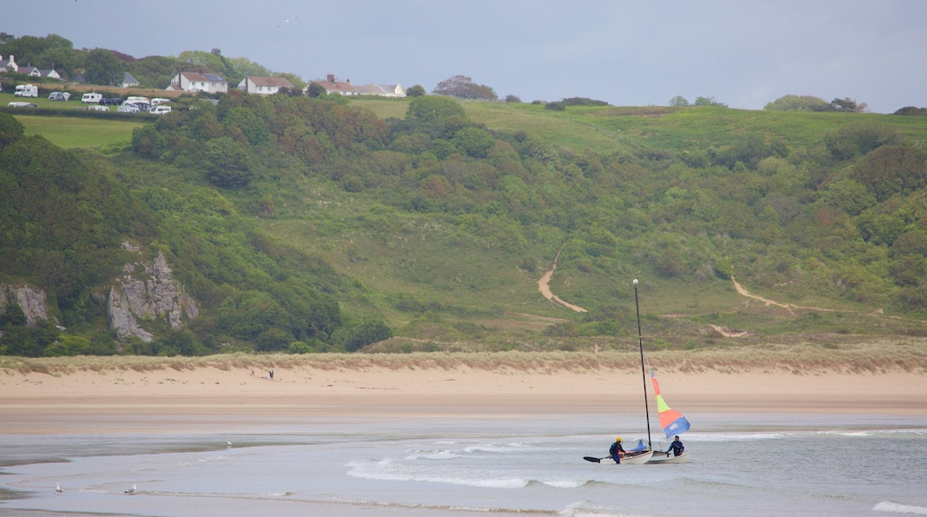 Oxwich Bay Beach which includes a bay or harbour and a beach