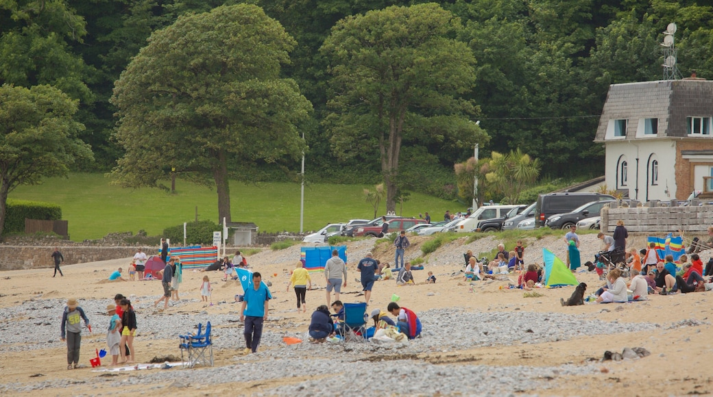 Oxwich Bay Beach showing a beach as well as a large group of people