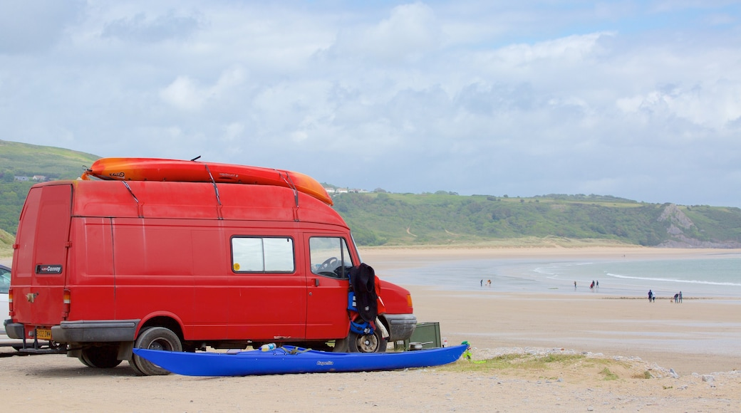 Oxwich Bay Beach featuring a beach and vehicle touring