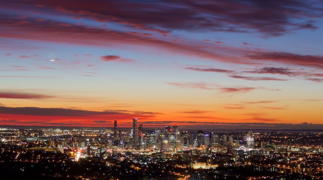 Mt. Coot-Tha showing a city, night scenes and a sunset