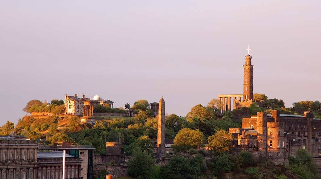 Calton Hill featuring a small town or village and a sunset