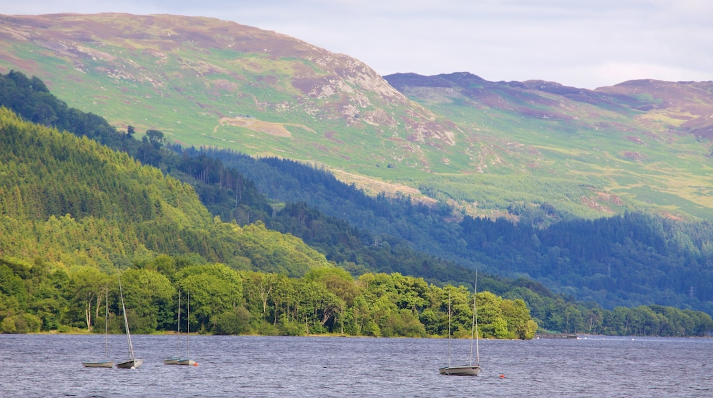 Loch Earn which includes mountains, a lake or waterhole and forest scenes