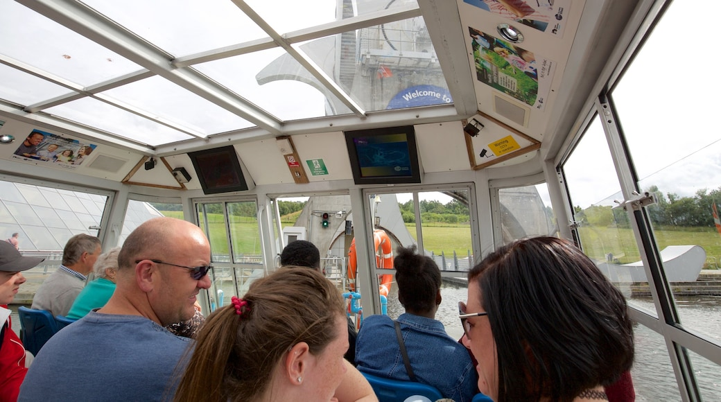 Falkirk Wheel showing boating and interior views as well as a large group of people