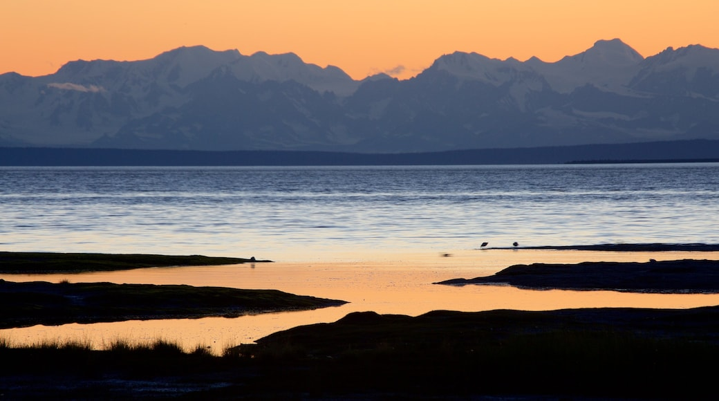 Anchorage featuring a sunset, mountains and general coastal views