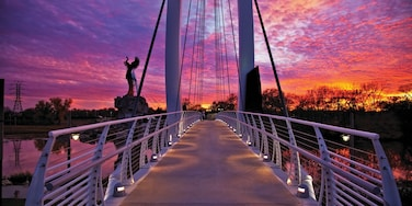 Wichita featuring a sunset and a bridge