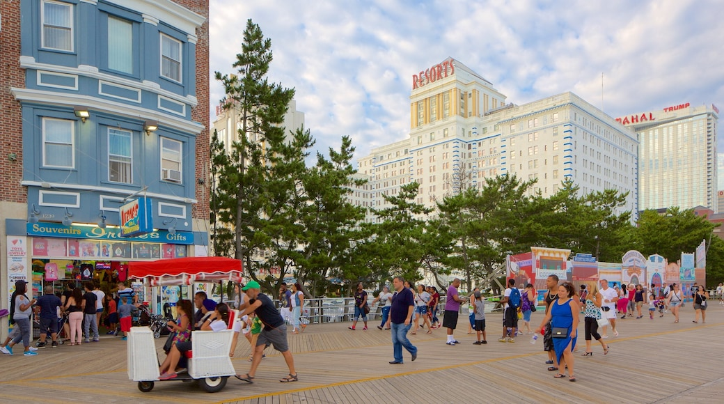 Atlantic City Boardwalk featuring a city and street scenes as well as a large group of people