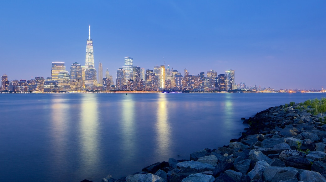 Liberty State Park featuring a sunset, a high-rise building and a city