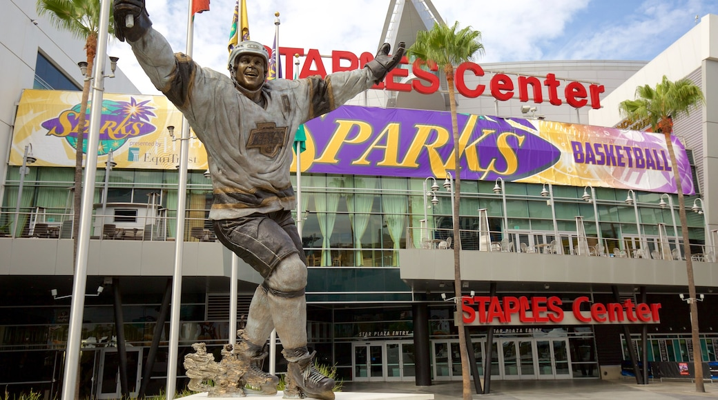 Staples Center which includes a statue or sculpture and signage