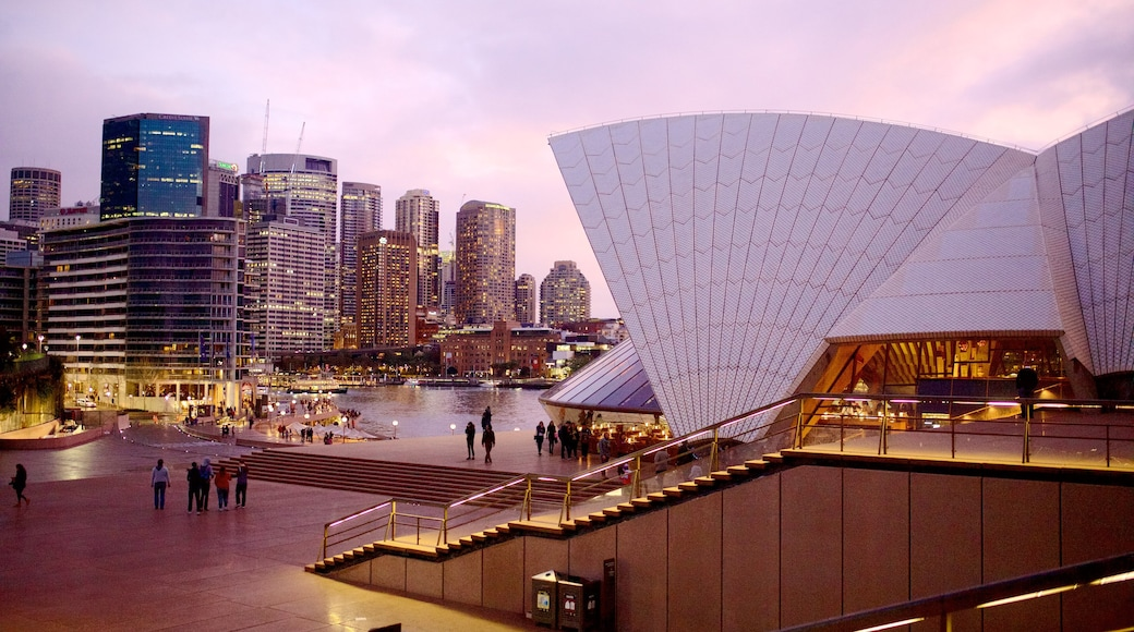 Sydney Opera House featuring modern architecture, central business district and night scenes