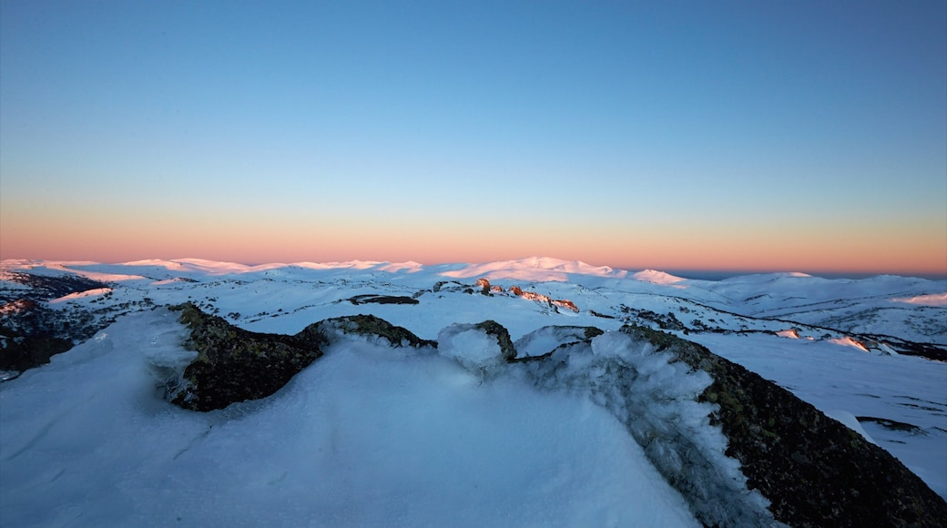 Perisher Ski Resort featuring mountains, skyline and a sunset