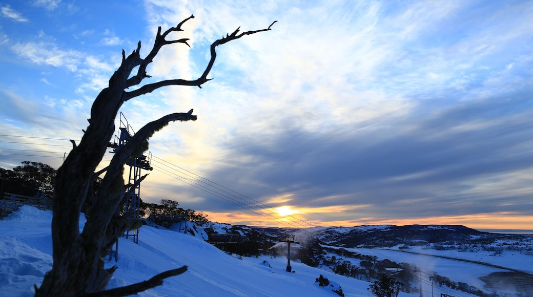 Perisher Ski Resort which includes snow, landscape views and a sunset