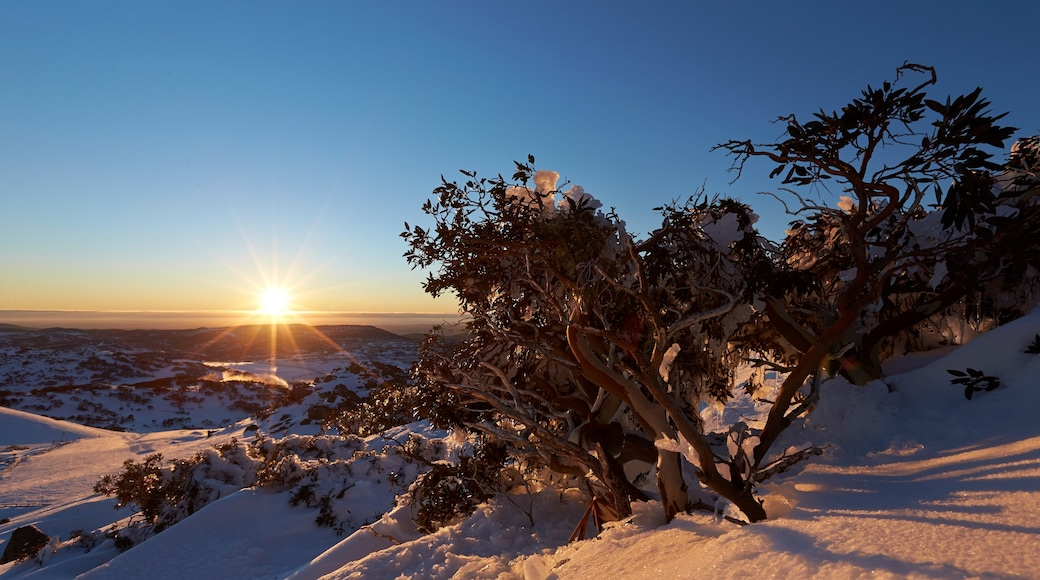 Perisher Ski Resort which includes landscape views, a sunset and snow