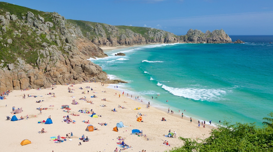 Porthcurno Beach featuring a sandy beach, swimming and landscape views